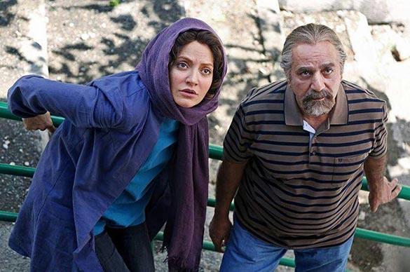 پرویز پرستویی و مهناز افشار در نمایی از فیلم سینمایی
